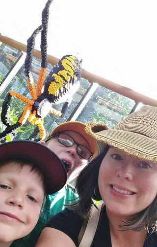 Anna and boys at arboretum with spider (2)