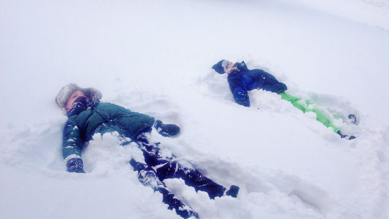 Making snow angels (3)