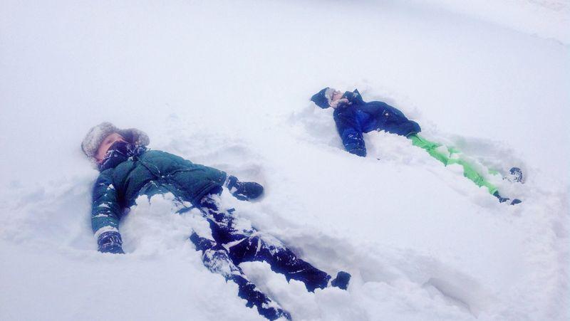 Making snow angels (3)